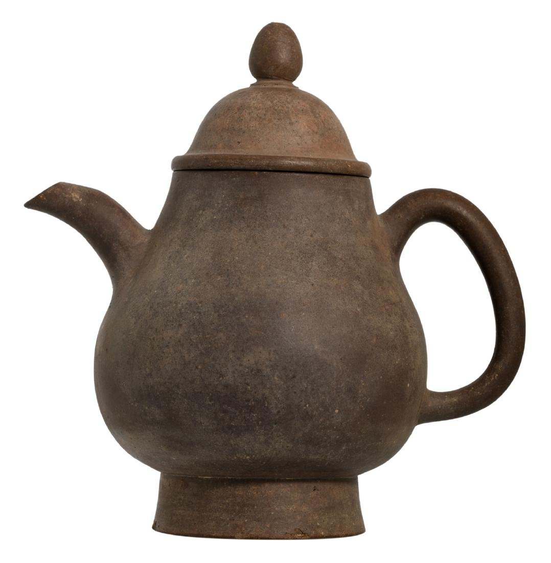 A Chinese Yixing teapot and cover, marked,H 22,5 - W