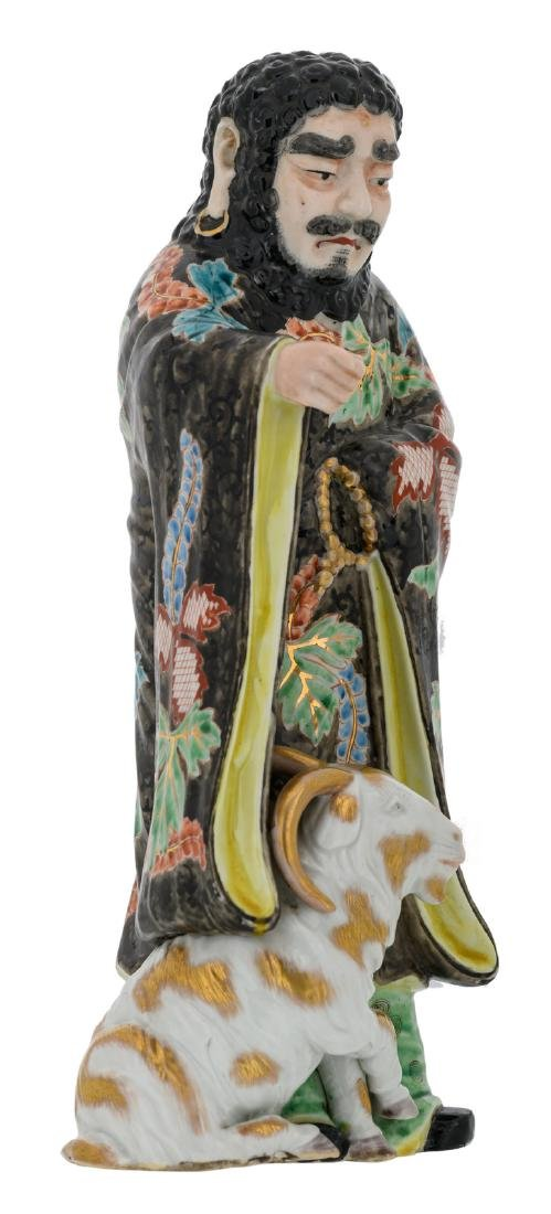 A Chinese polychrome decorated figure depicting a deity