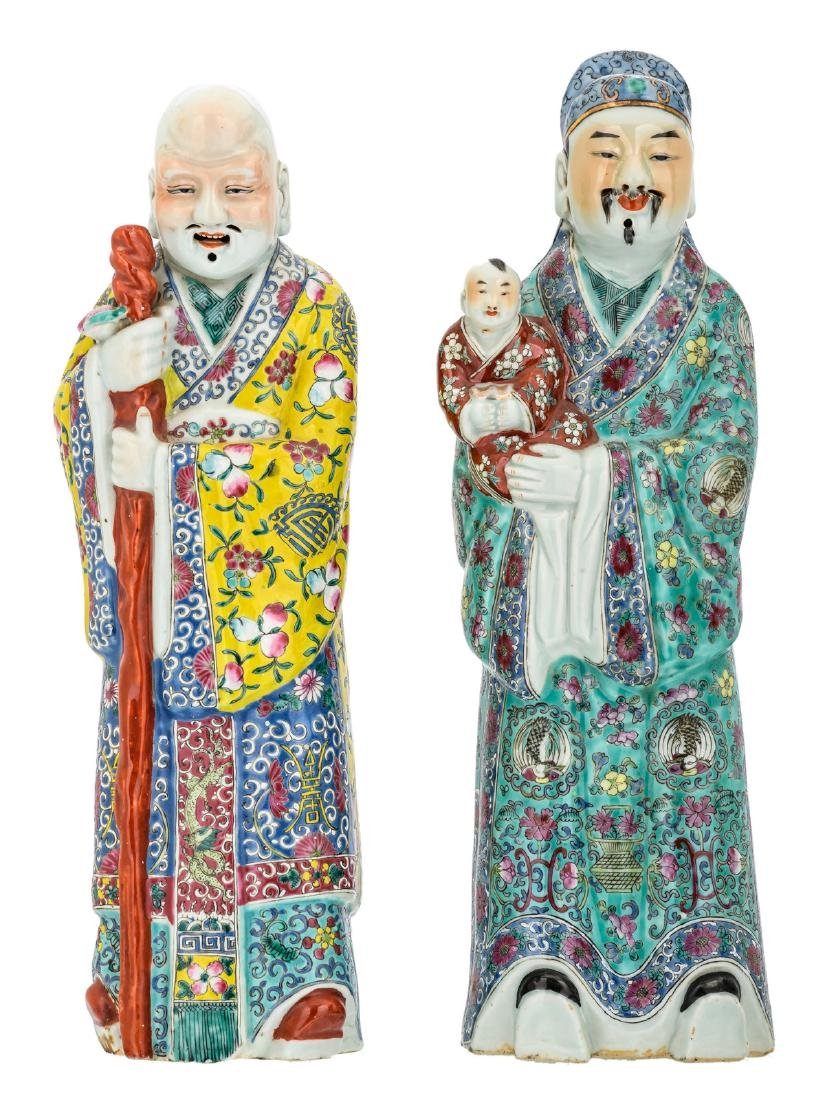 Two Chinese polychrome decorated figures depicting Fu