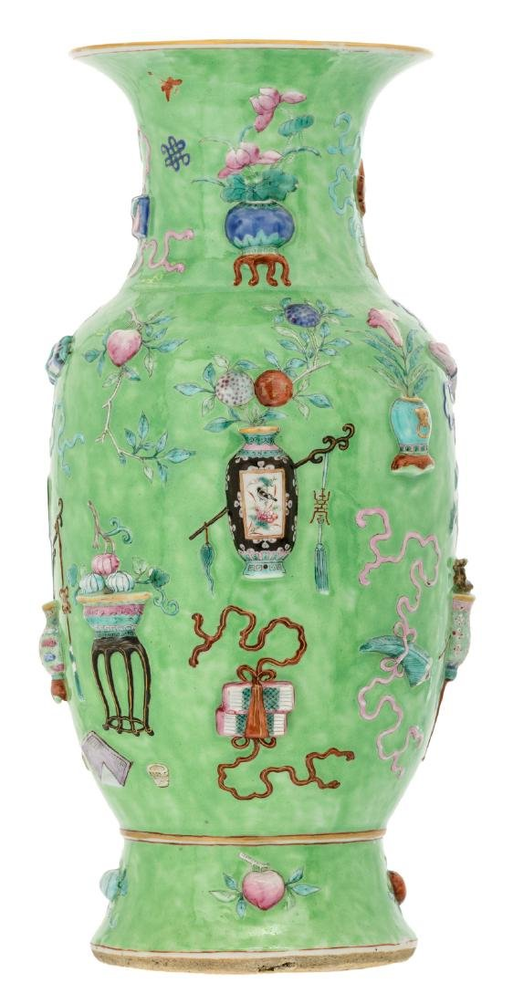 A Chinese green ground famille rose relief moulded vase