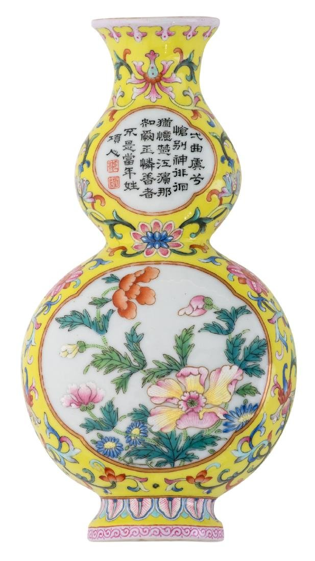A Chinese yellow ground famille rose floral decorated