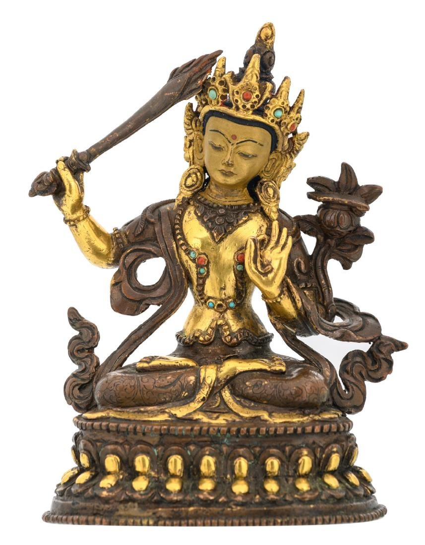 A Sino-Tibetan gilt bronze Manjushri Bodhisattva with