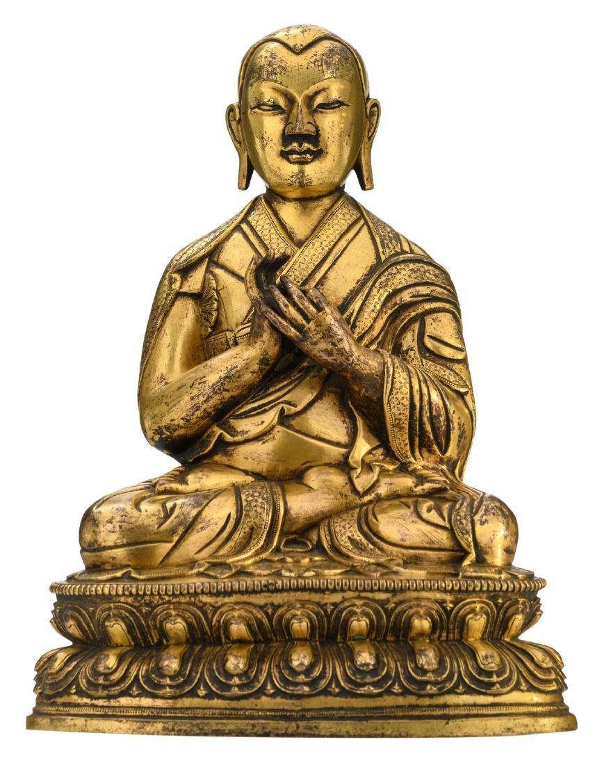 A Sino-Tibetan gilt bronze seated Buddha,H 32 - W 23