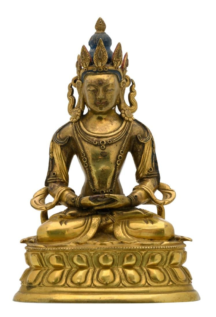 A Sino-Tibetan gilt bronze seated Buddha with traces of
