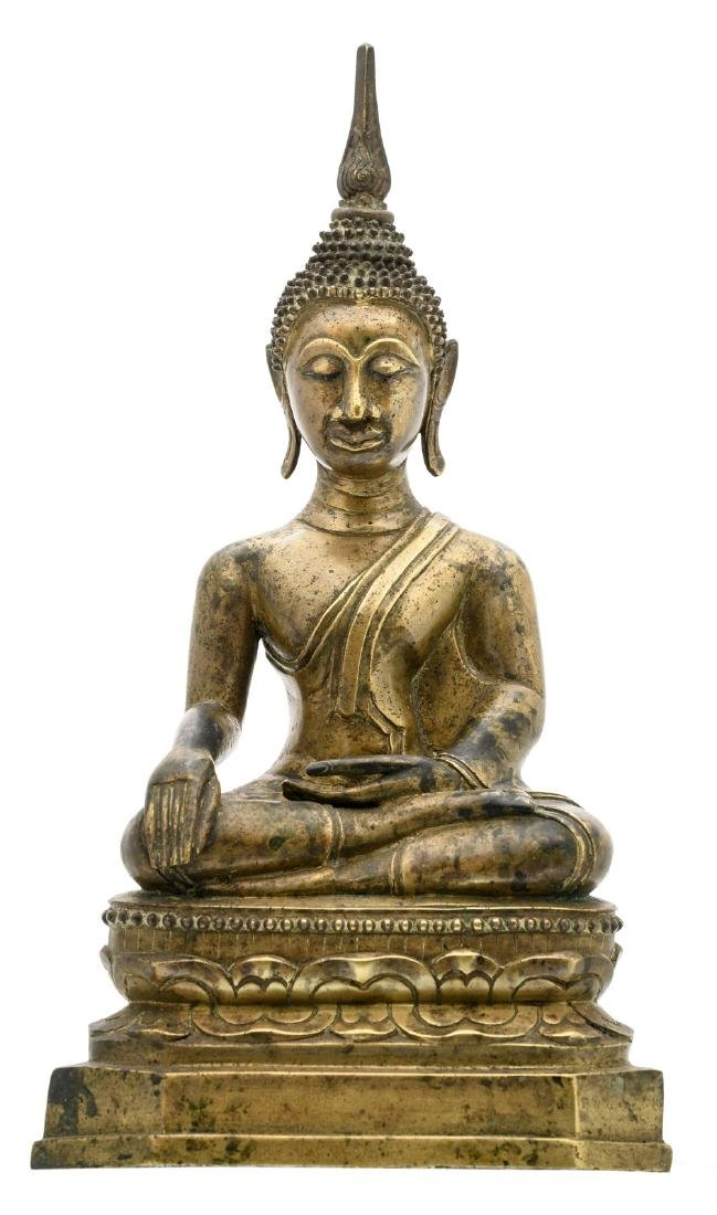 An Oriental bronze seated Buddha with a calligraphic