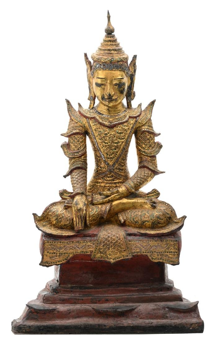 An Oriental polychrome gilt lacquered seated Buddha