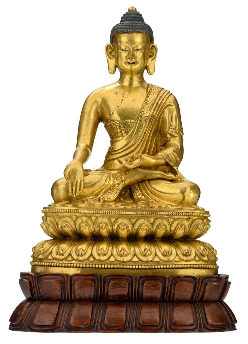 A Chinese gilt bronze seated Buddha with traces of