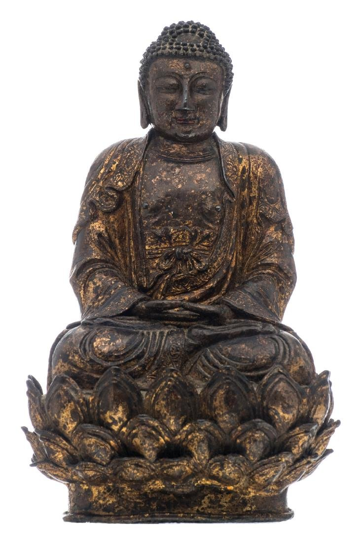 A Chinese seated gilt lacquered bronze Buddha with