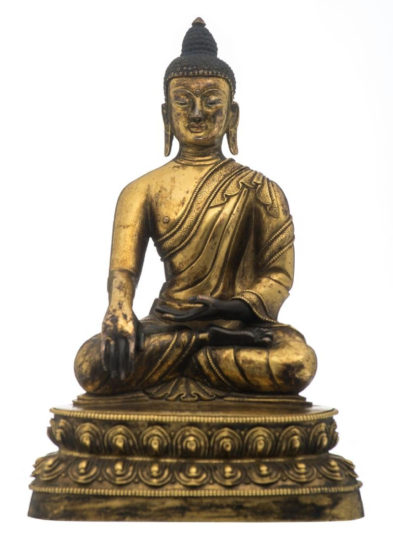 A Chinese seated gilt bronze Buddha with traces of