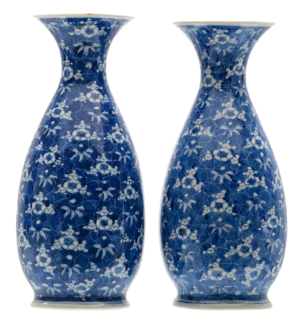Two Japanese blue and white floral decorated vases,