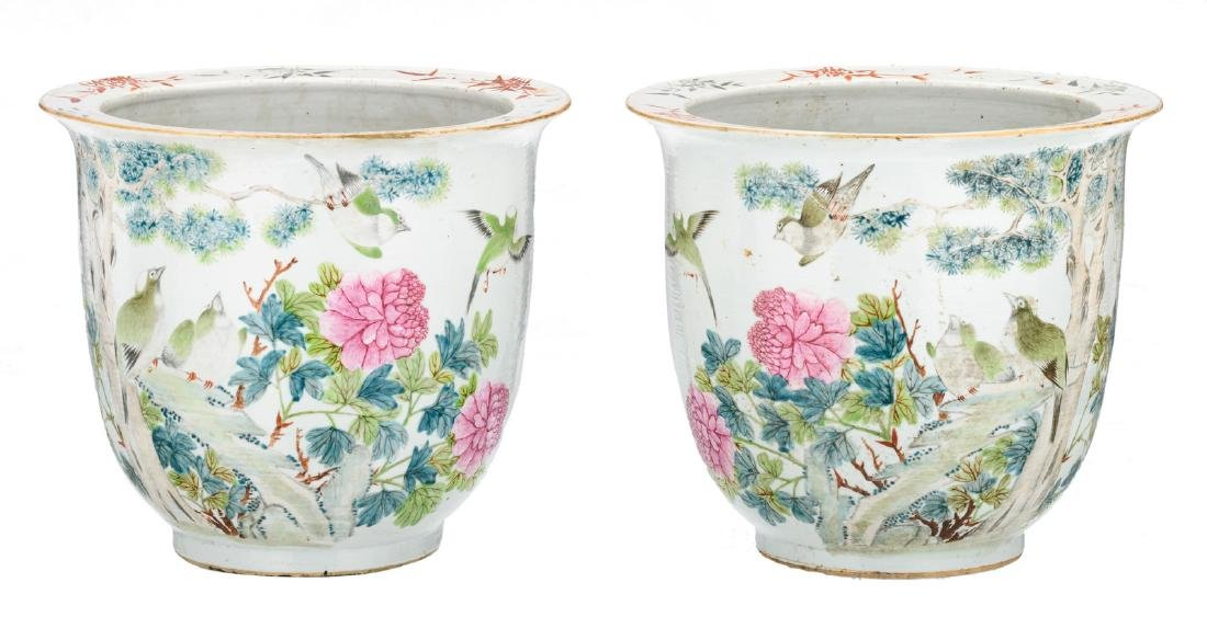 A pair of Chinese jardinieres, decorated with birds on