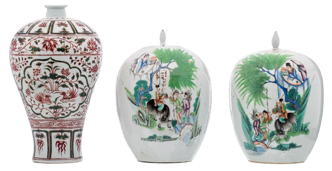 A pair of Chinese polychrome decorated ginger jars and