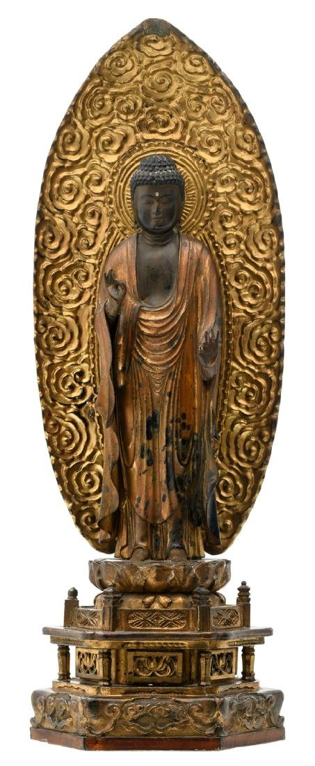 A Japanese sculpted gilt lacquered wooden Buddha on a
