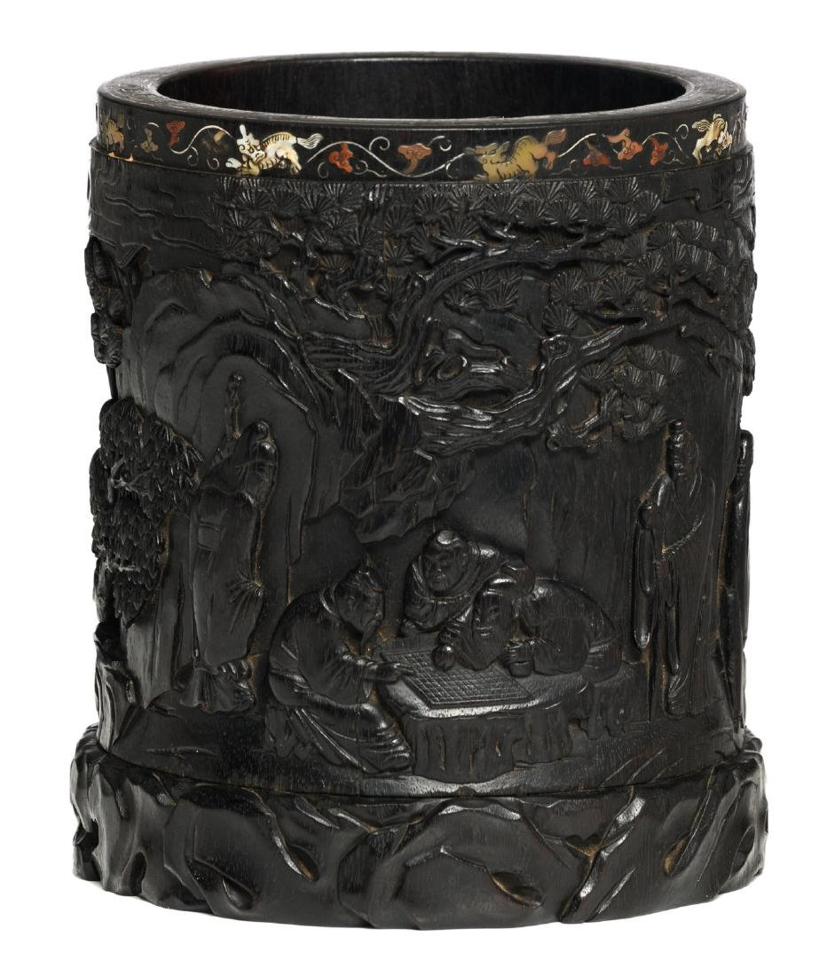 A Chinese carved zitan wood brushpot, overall decorated