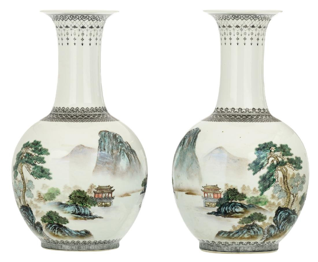 A pair of Chinese polychrome decorated bottle vases