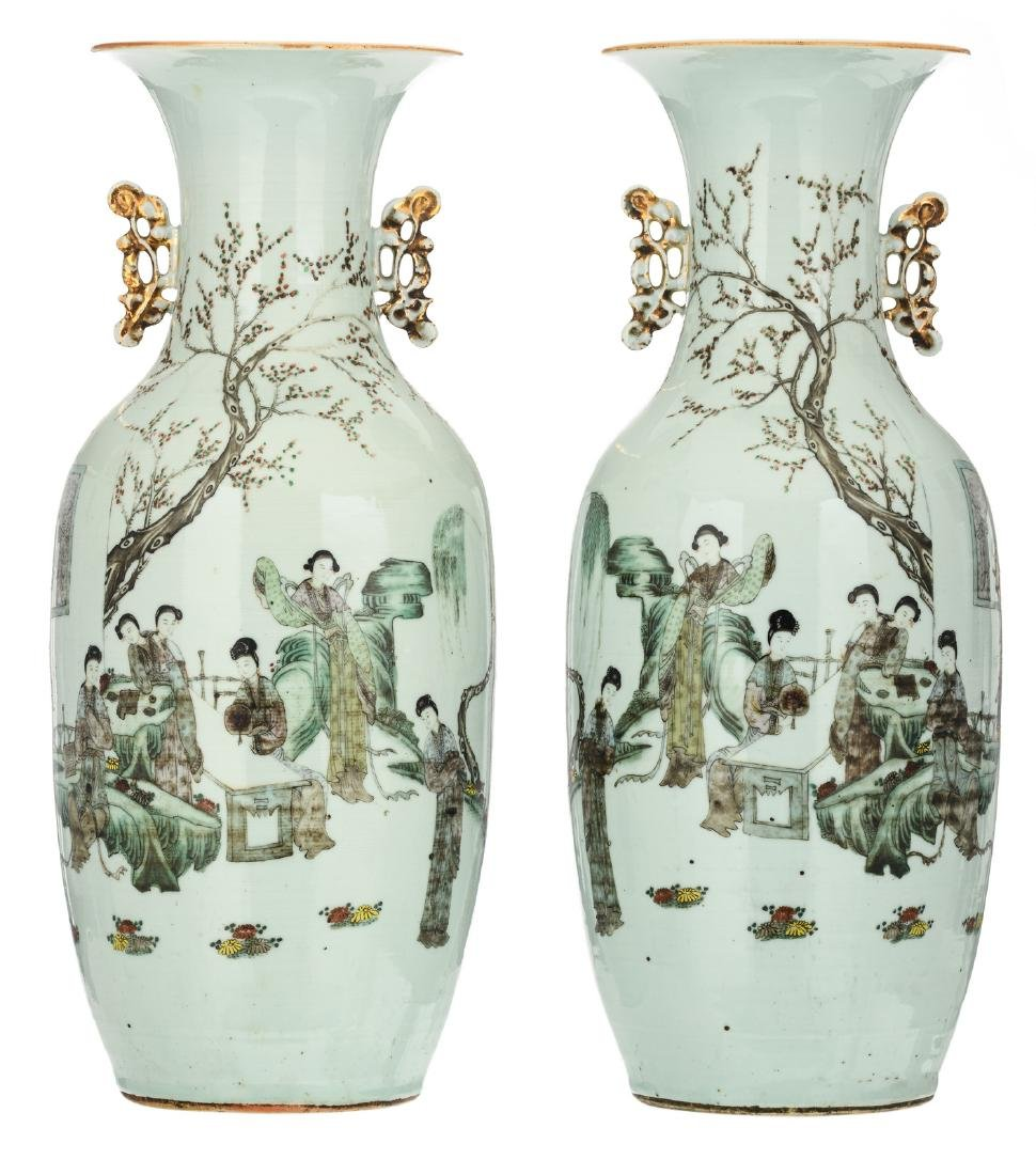 A pair of Chinese polychrome decorated vases with a