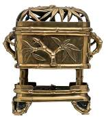 A Chinese bamboo relief and open work decorated bronze