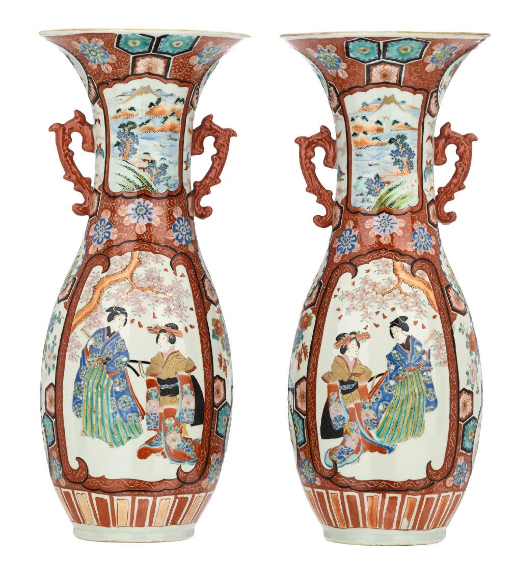 A pair of Japanese polychrome floral decorated vases,