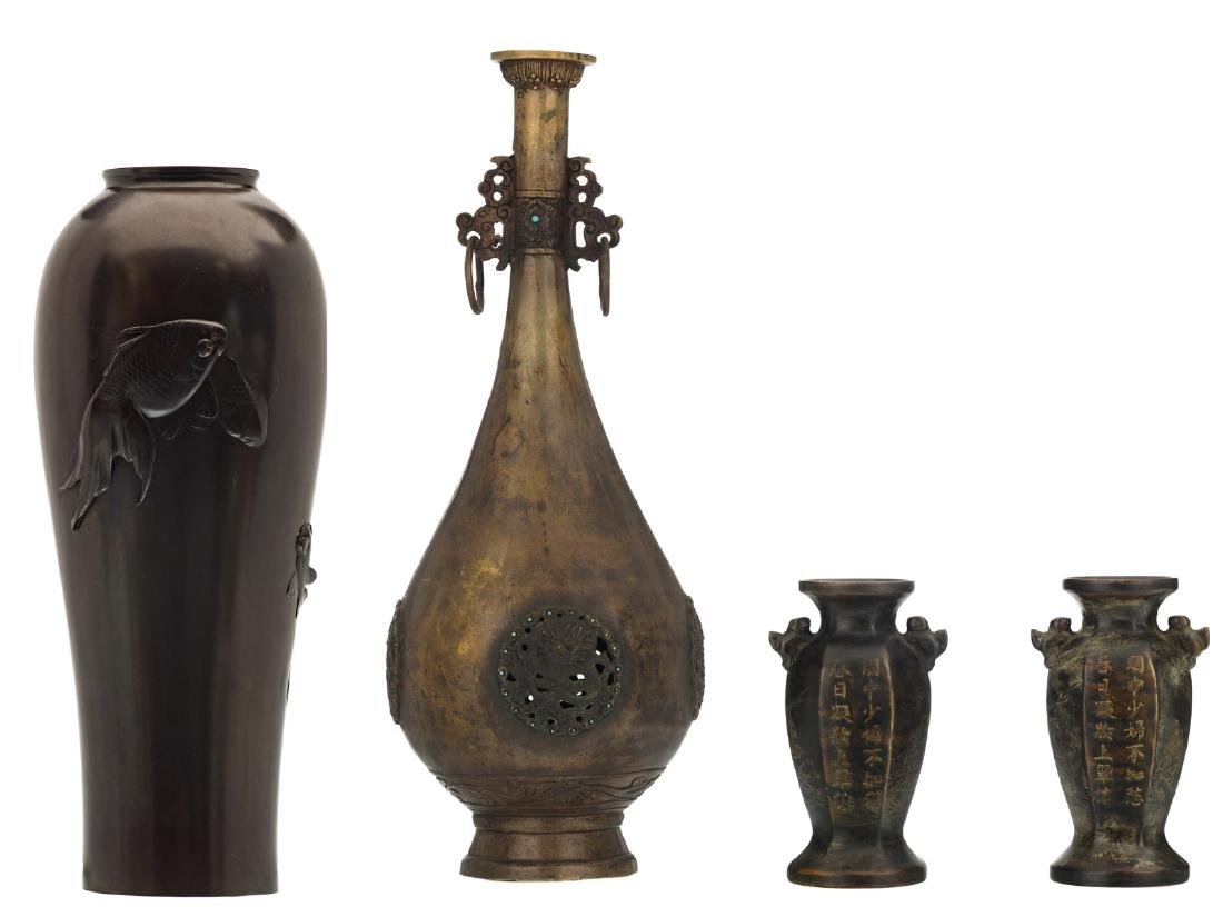 A Japanese patinated and relief decorated bronze vase