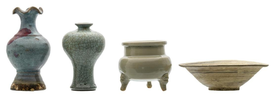 Two Chinese vases and a tripod incense burner in the