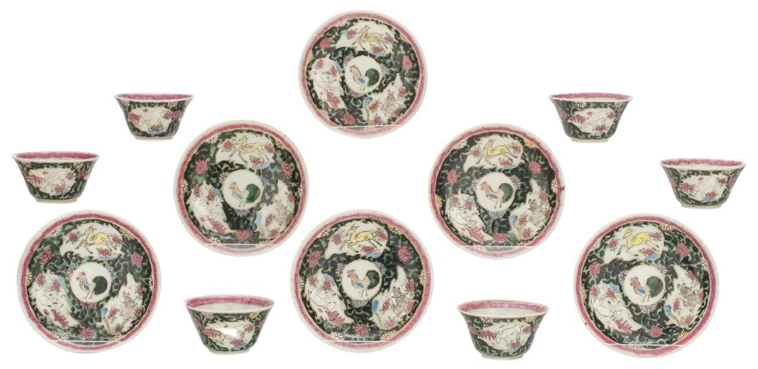A set of six Chinese famille noire cups and saucers,