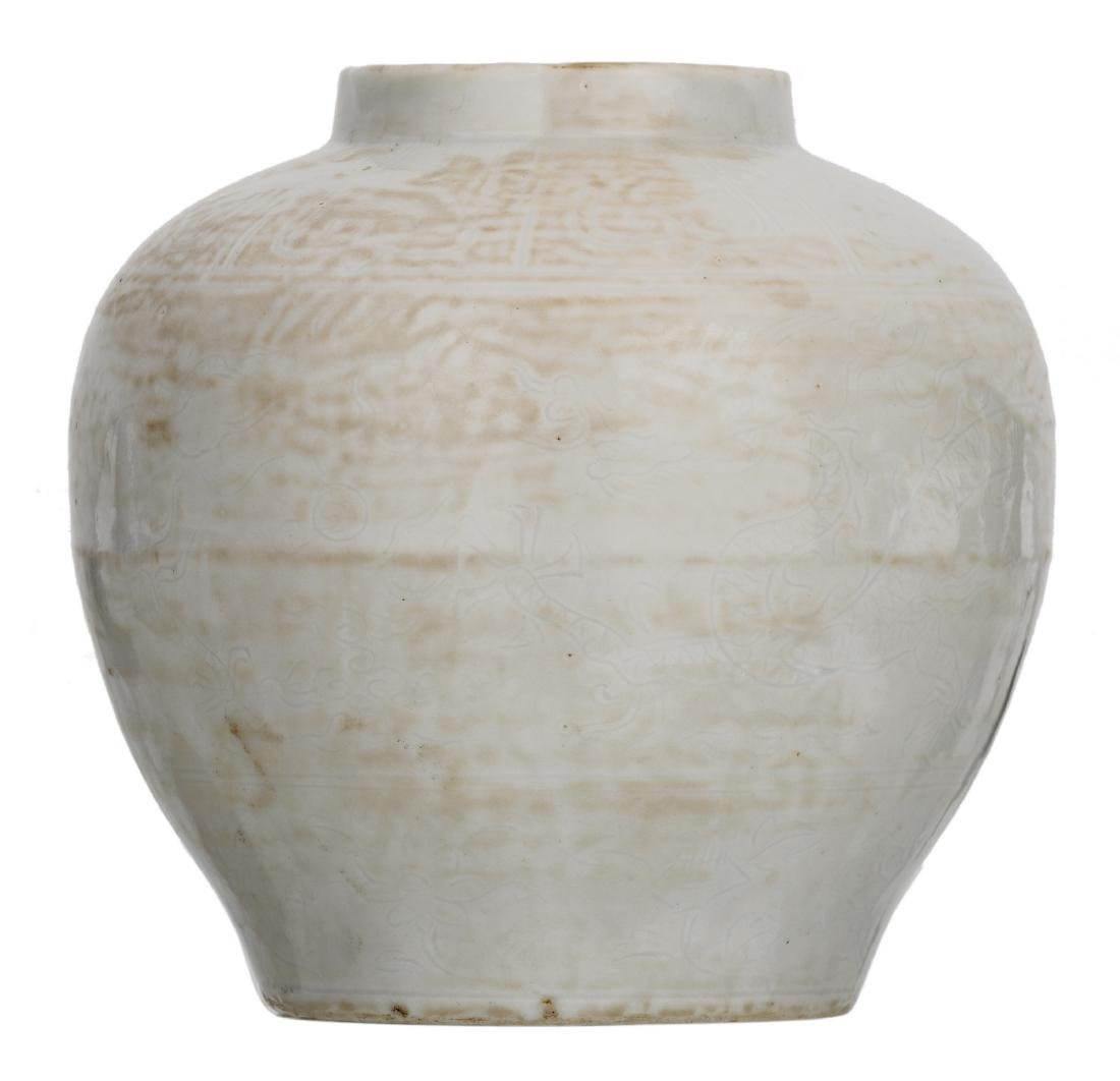 A Chinese white glazed incised dragon jar, Wanli