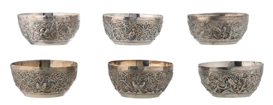 Six Chinese overall relief decorated silver bowls with