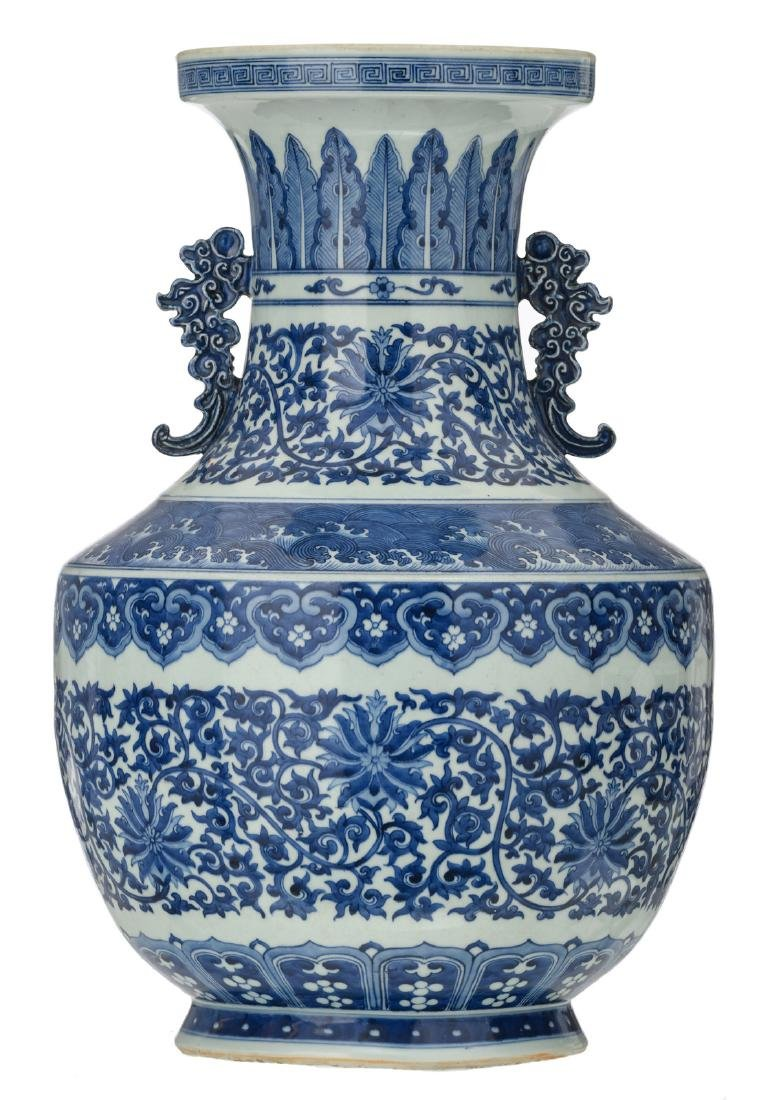 A Chinese blue and white floral decorated vase with