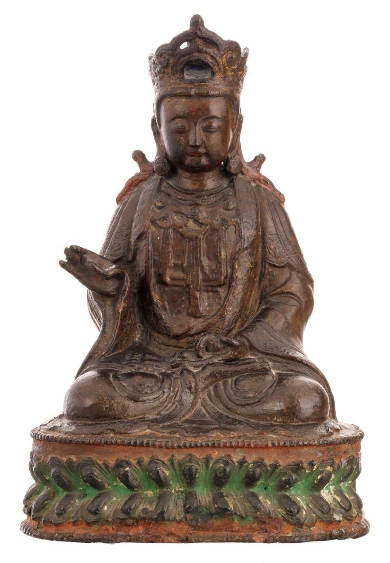 A Chinese seated bronze Buddha with traces of gilt