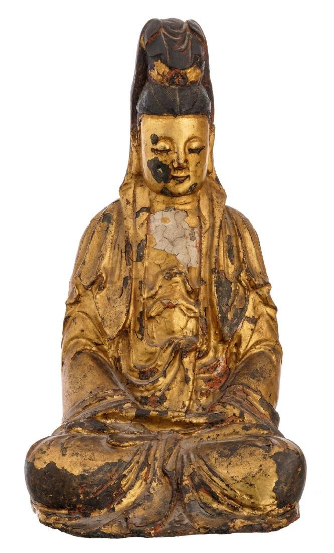 A Chinese gilt lacquered seated bronze Guanyin with