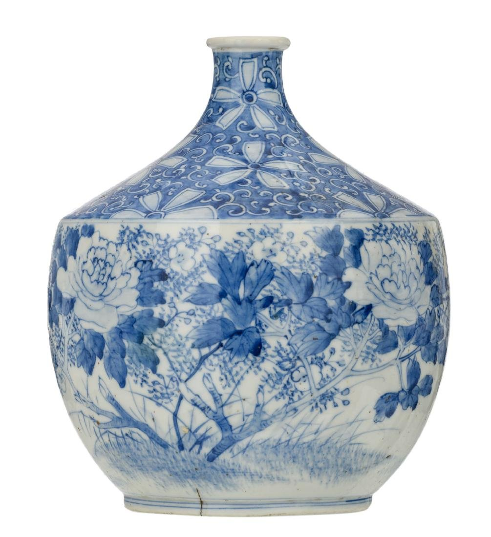 A Japanese blue and white decorated vase with flower