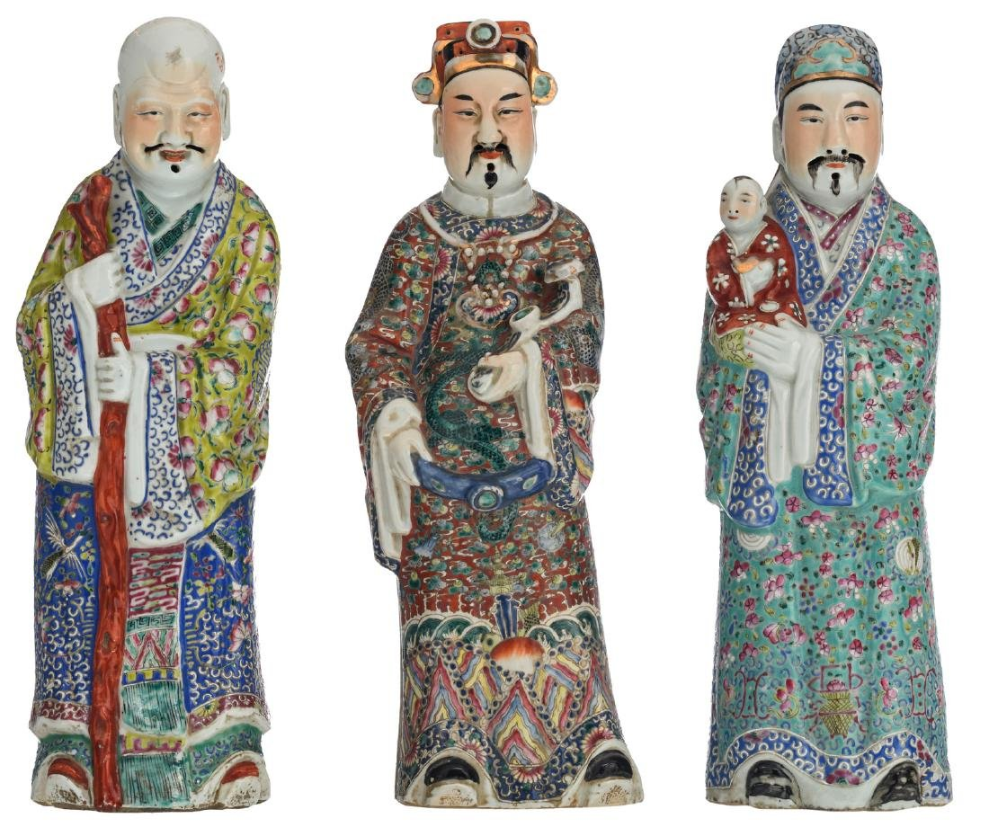 Three Chinese polychrome decorated figures depicting
