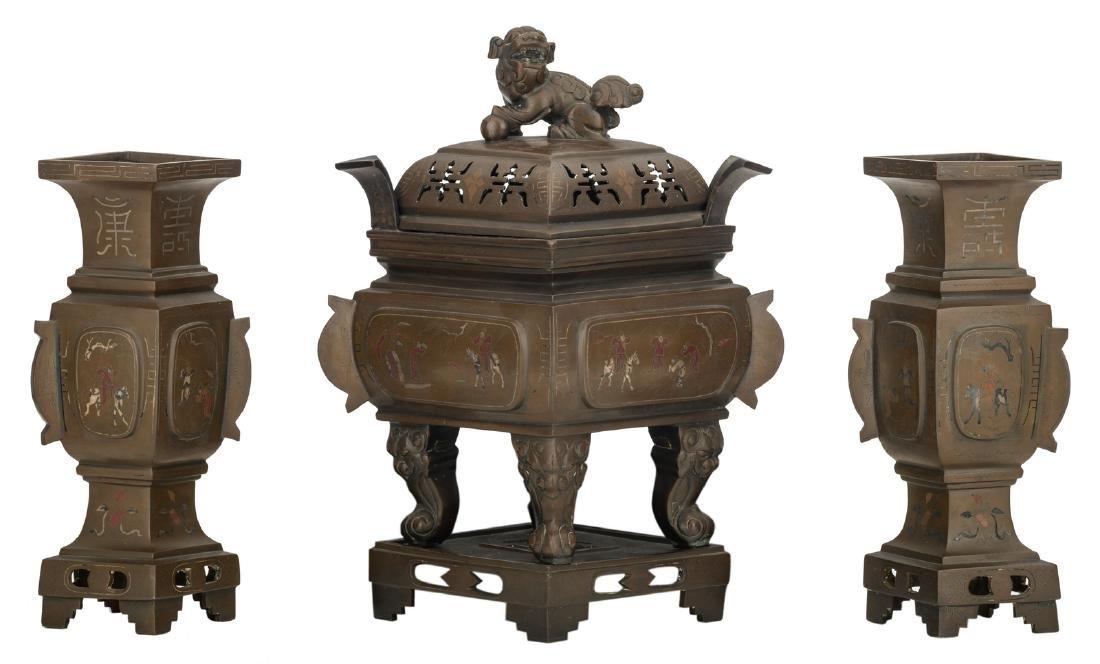A Chinese three-piece bronze quadrangular garniture,