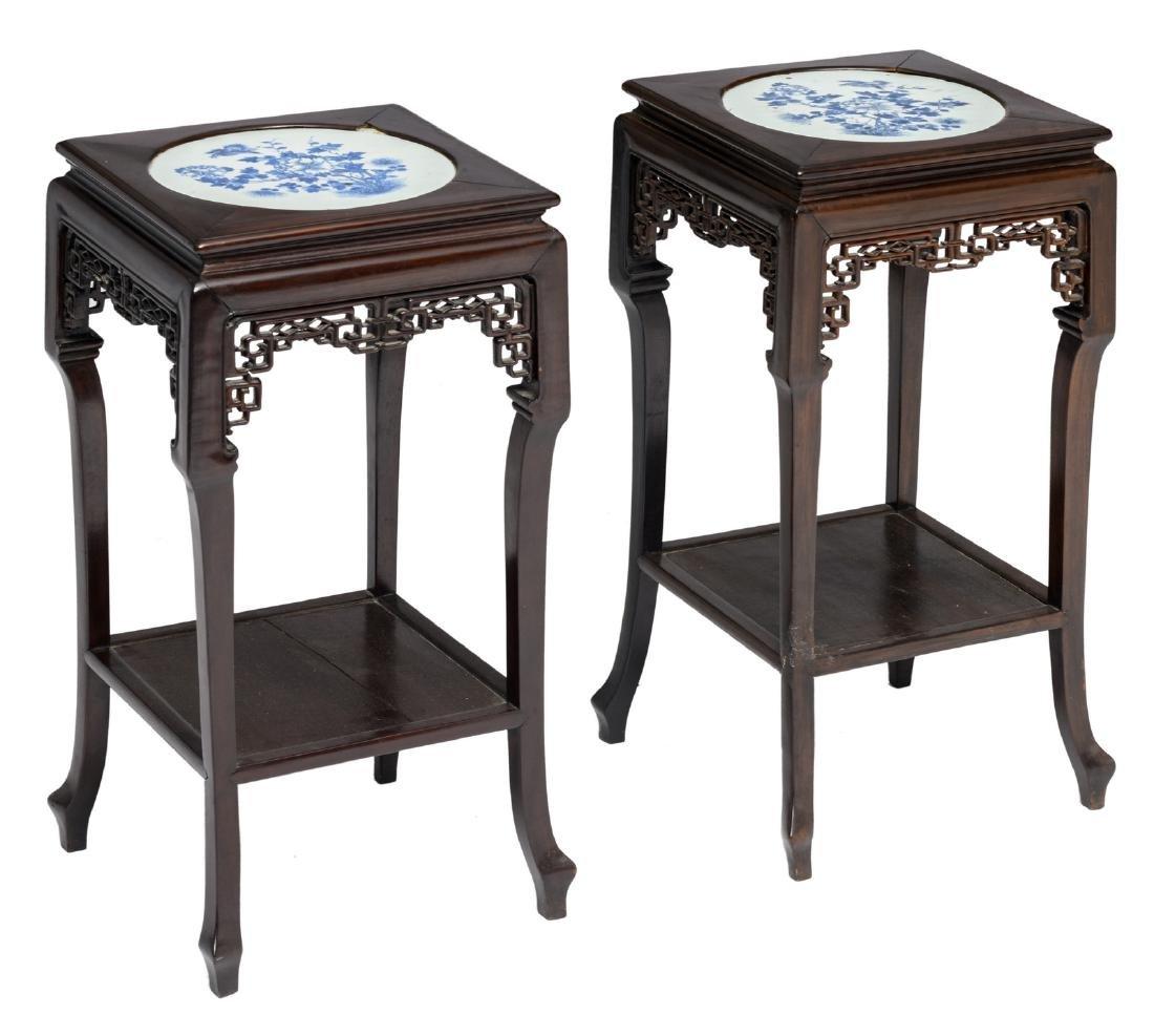A pair of Chinese quadrangular carved hardwood