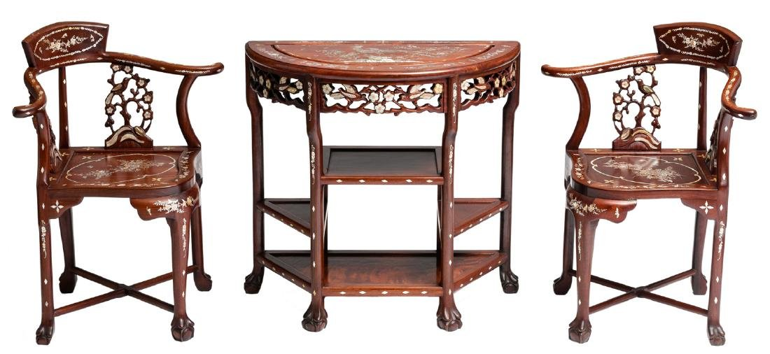 An Oriental crescent shaped wooden side table with