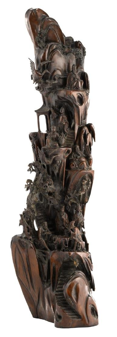 A Chinese wooden sculpture depicting the Eight