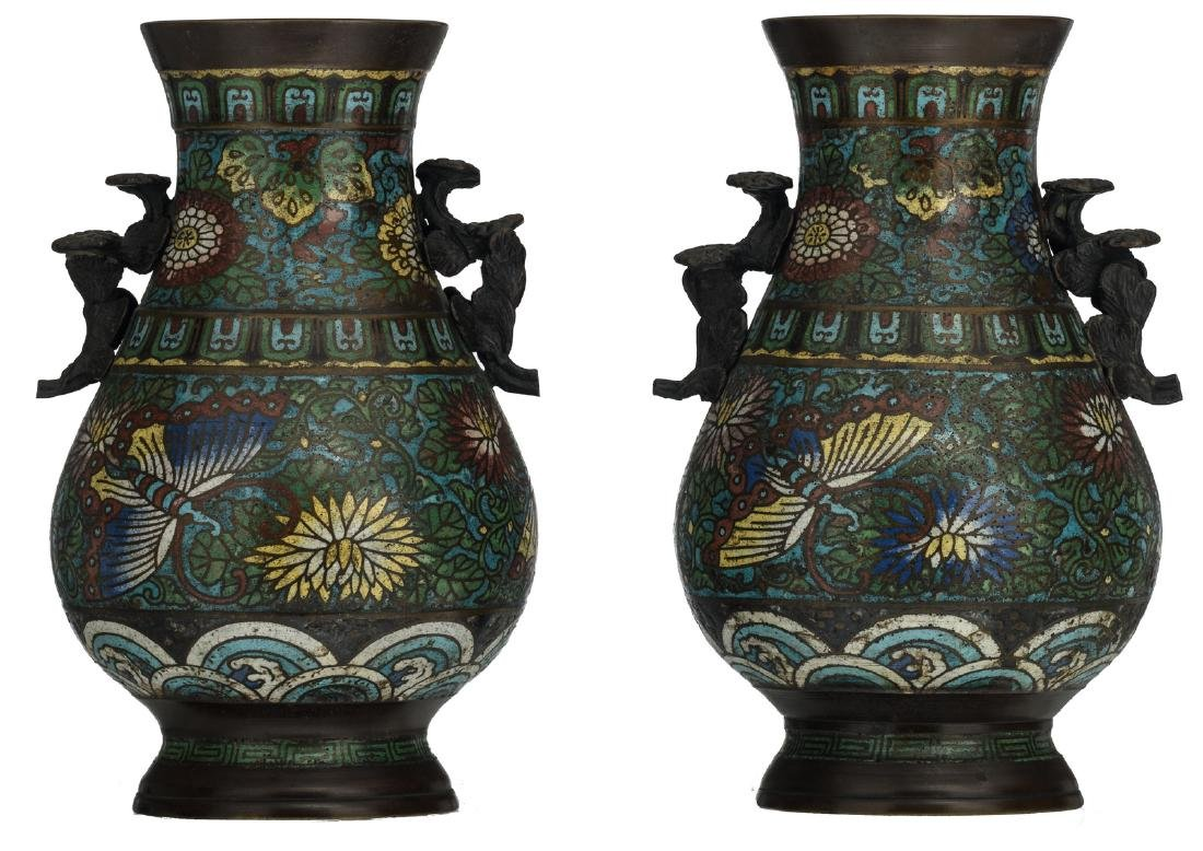 Two Chinese decorated cloisonne vases with flowers and