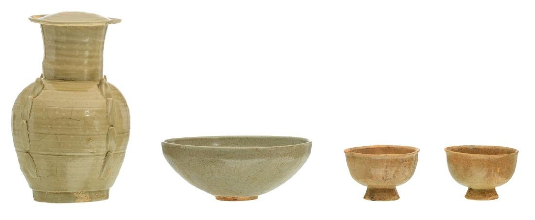 A Chinese vase and cover, a bowl and two cups, glazed