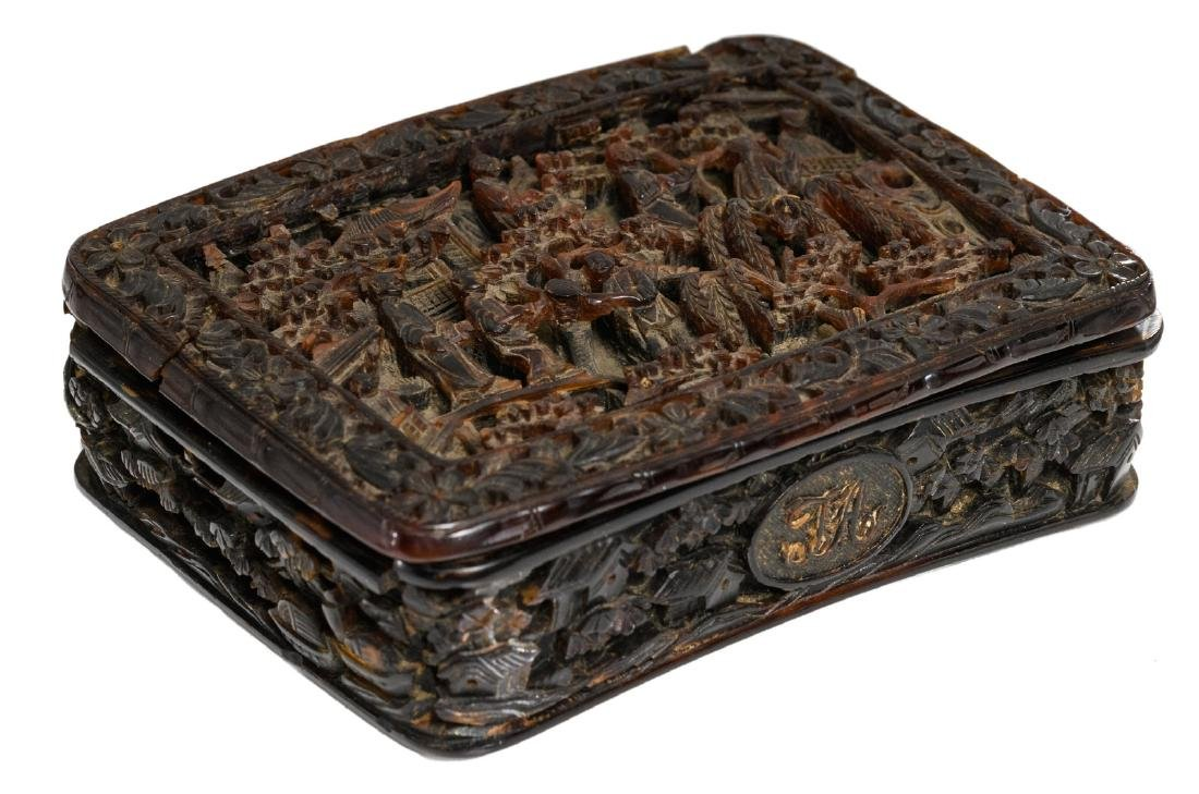A fine relief decorated chinoiserie tortoise shell