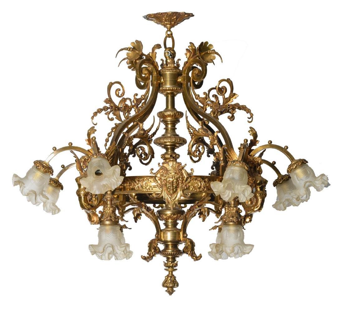 A rustic gilt bronze chandelier, H 96 - W 116 cm