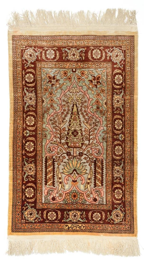 An Oriental silk and silver thread woven carpet, 43,5 x