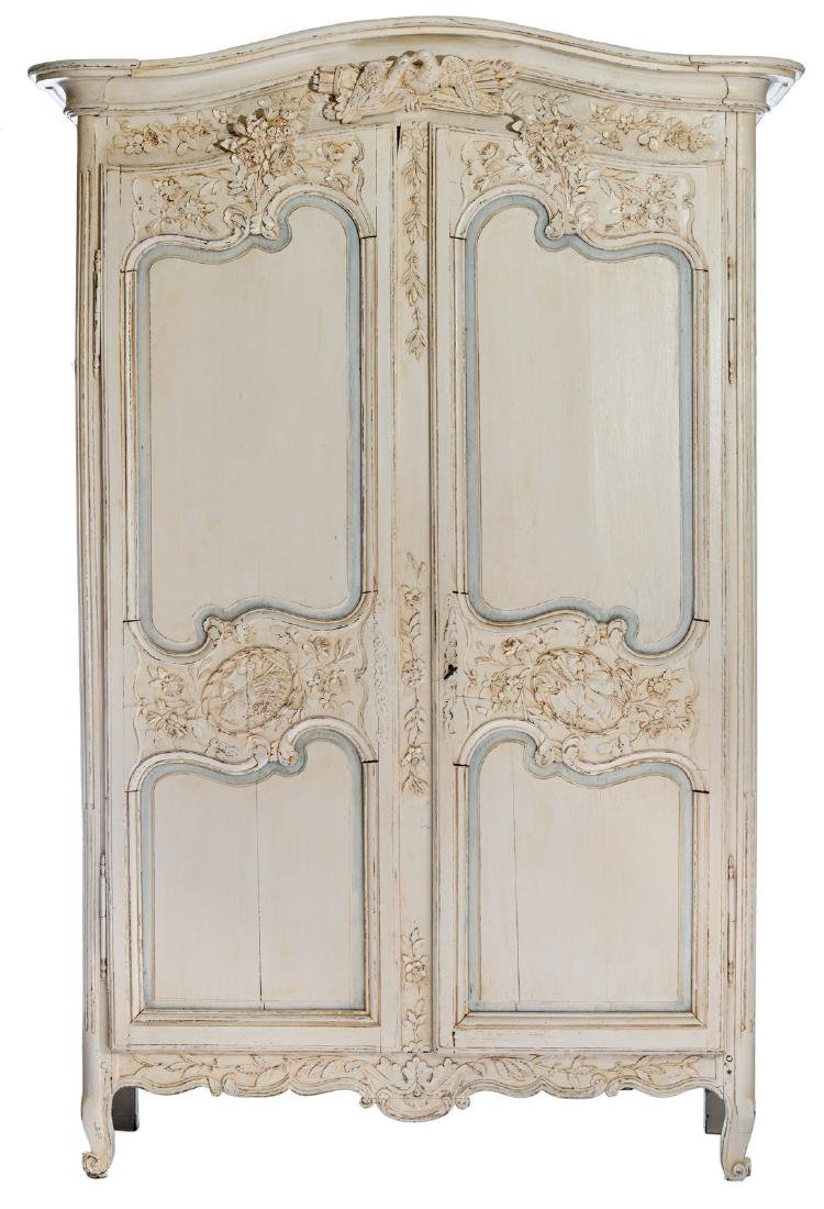 A 19thC oak wardrobe with polychrome decoration of a