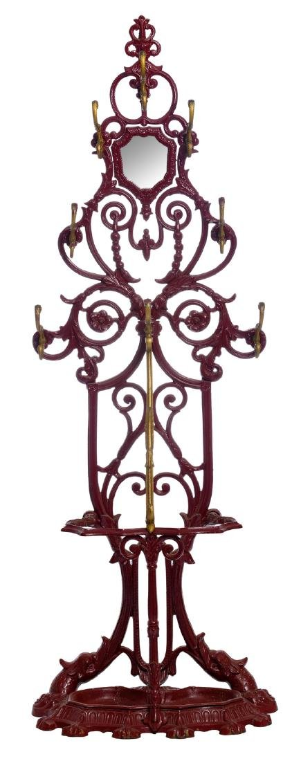 A red lacquered cast iron coat rack, H 195 - W 66 - D