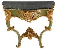 An Italian Rococo style polychrome and gilt decorated