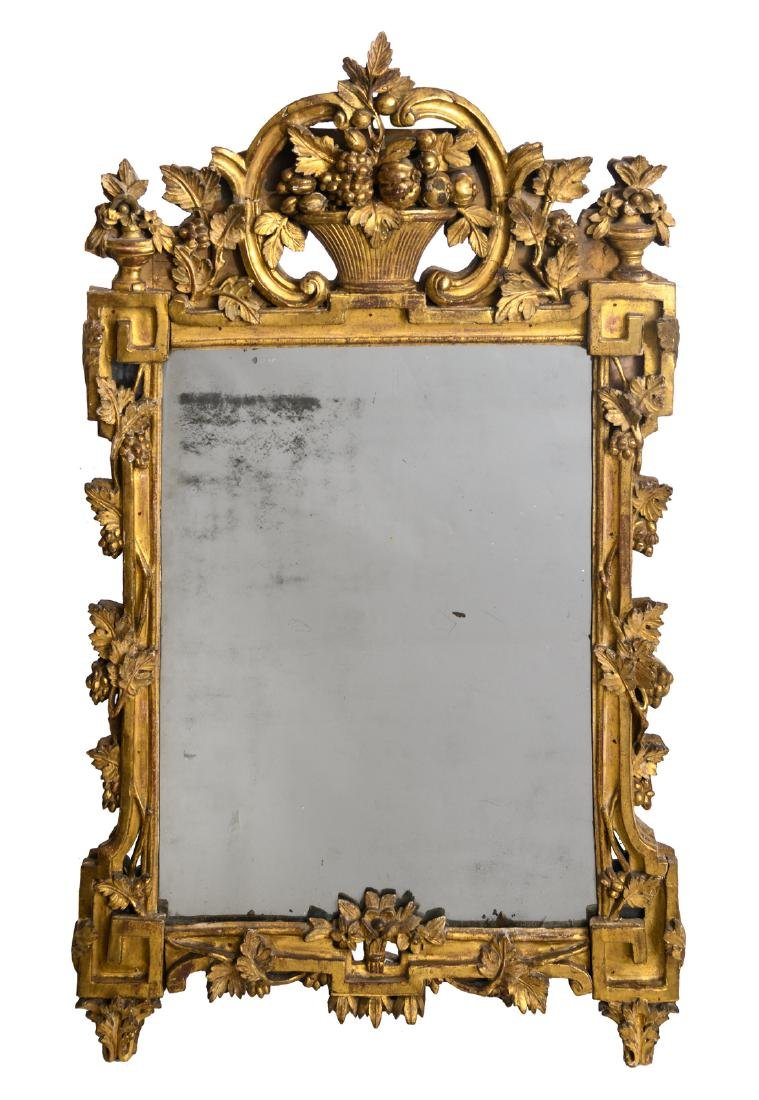 A mirror in a carved and gilt wooden Neoclassical 18thC