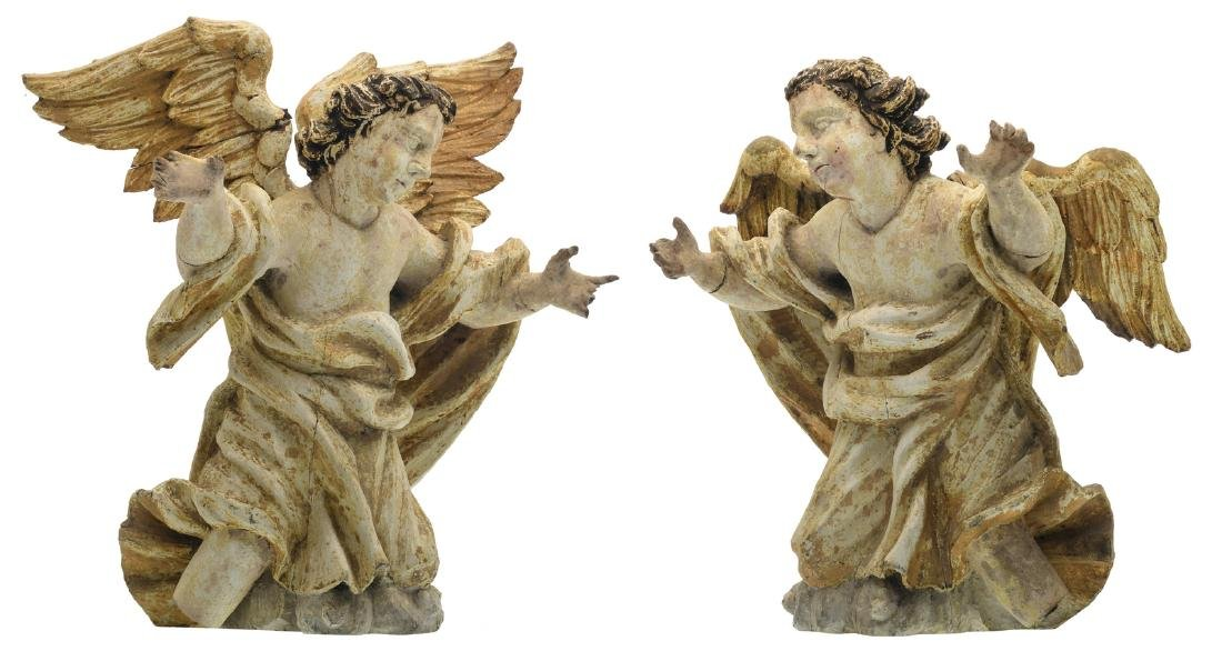 A pair of 18thC polychrome decorated wooden altar