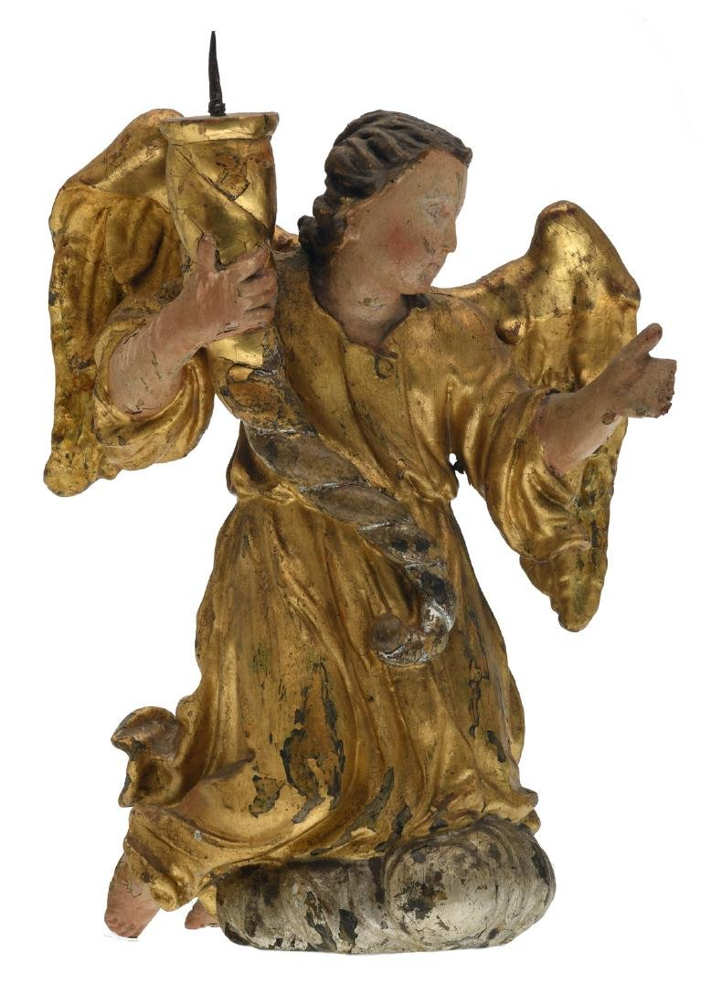 An early 18thC polychrome decorated and gilt wooden