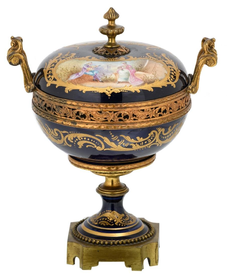 A bleu royal gold decorated pot and cover, the roundels