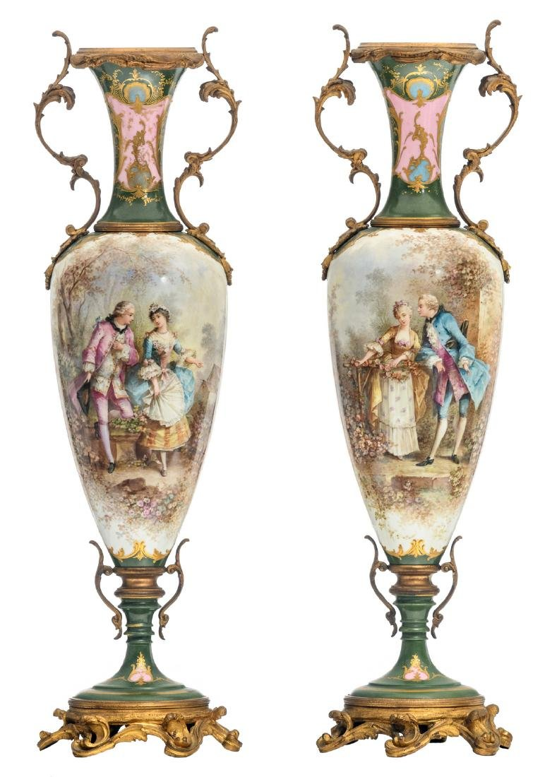 A pair of ornamental gilt bronze mounted green ground