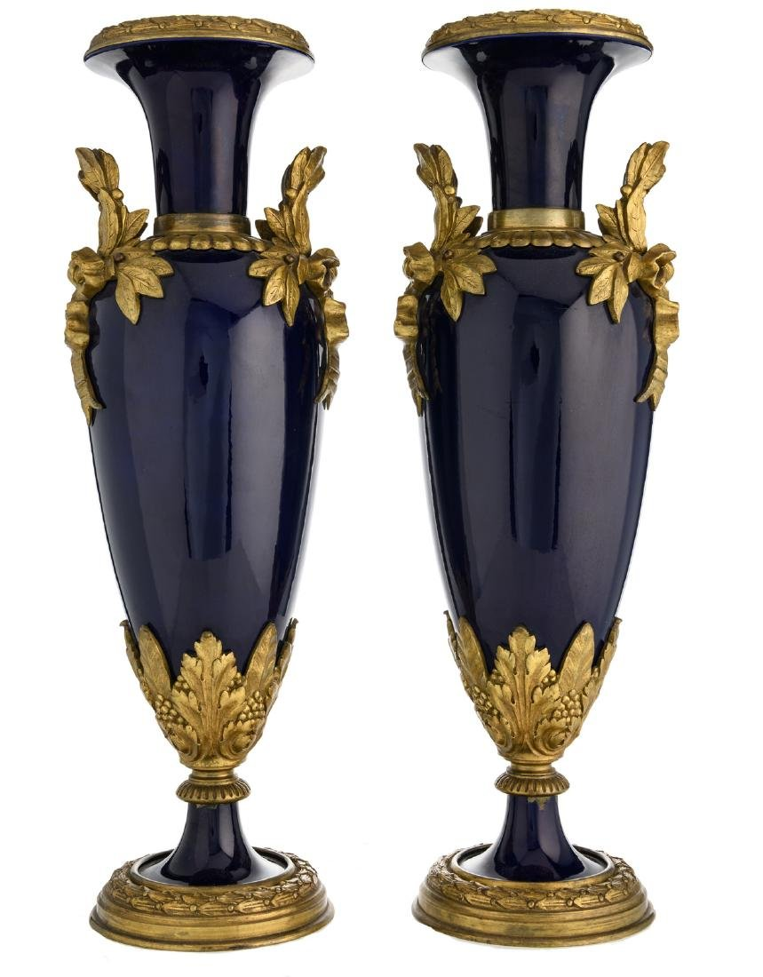 A pair of bleu royal bronze mounted Sevres vases, H 51